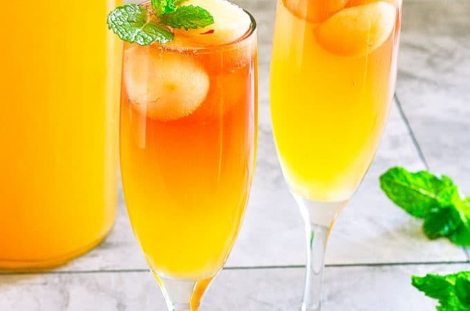 side angle of cider mimosa in champagne flute
