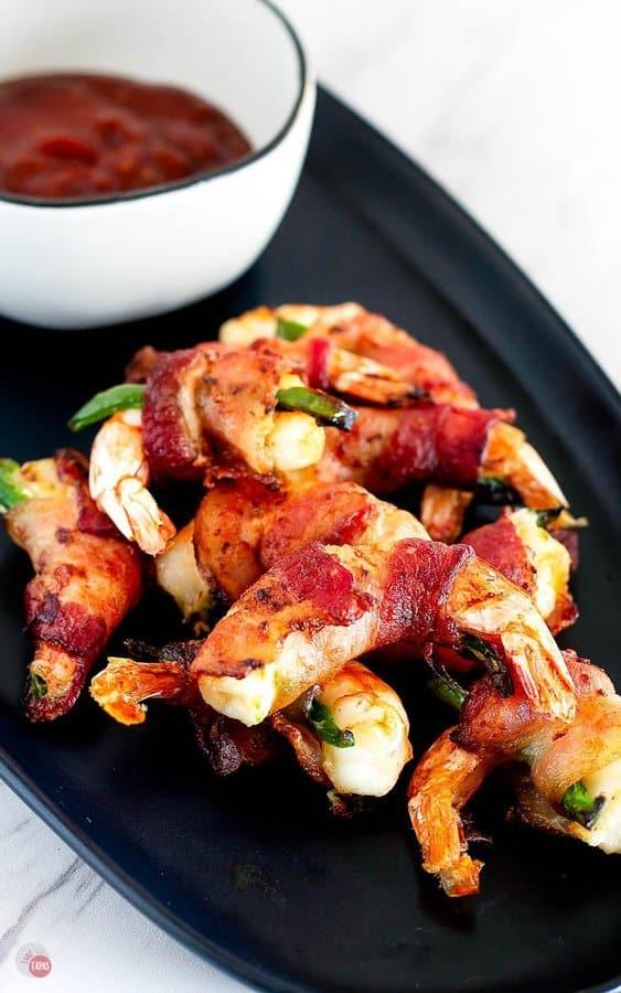 shrimp appetizers on a black plate