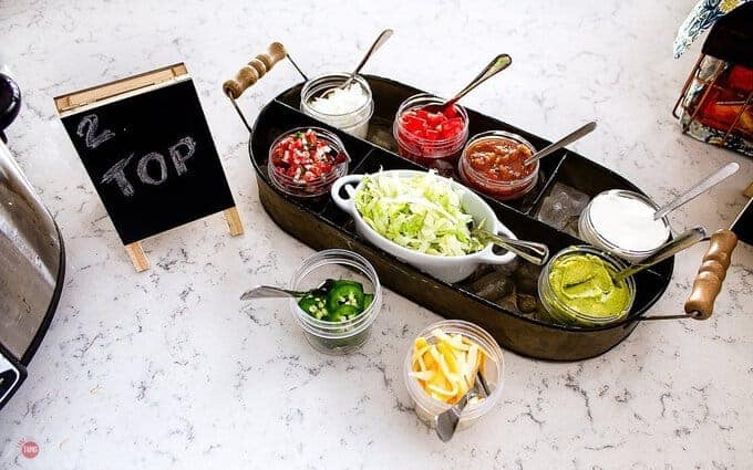 overhead picture of toppings for taco bar