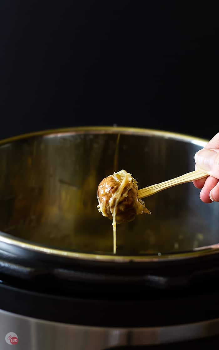 picture of pulling a meatball out of the instant pot