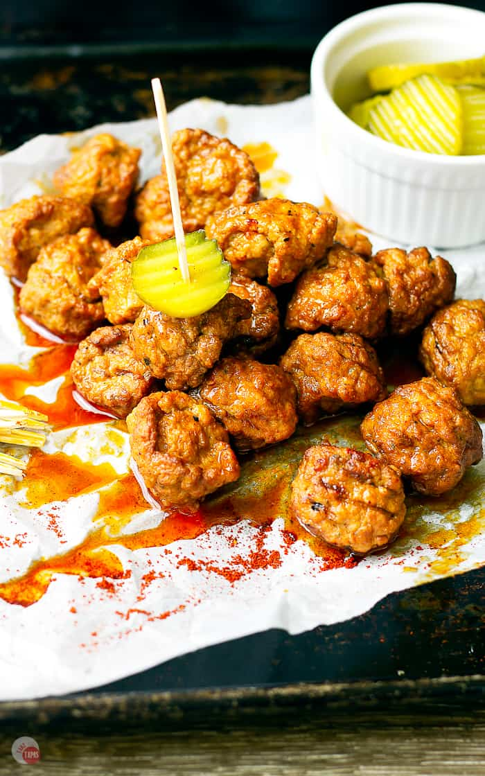 picture of hot chicken meatballs and pickles on toothpicks