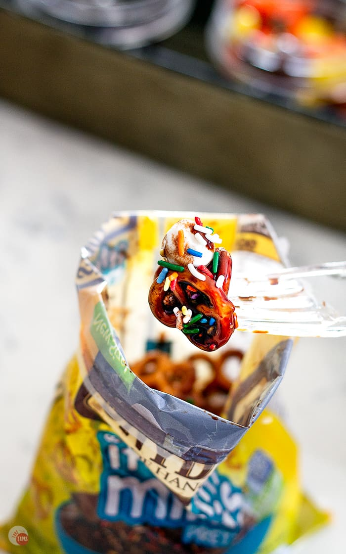 close up of pretzels with chocolate sauce and sprinkles