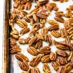 Buttered toasted pecans on a sheet pann