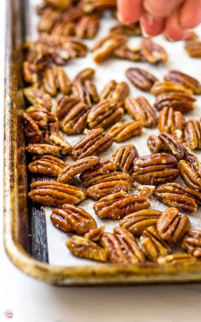 baking sheet of toasted pecans with salt