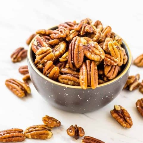 Butered toasted pecans in a bowl