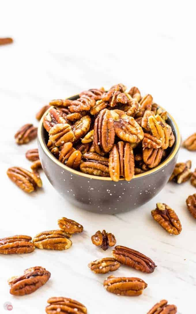 A small bowl of toasted pecans