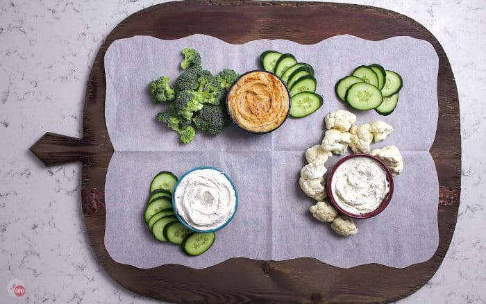 serving board with a few crudites and dips