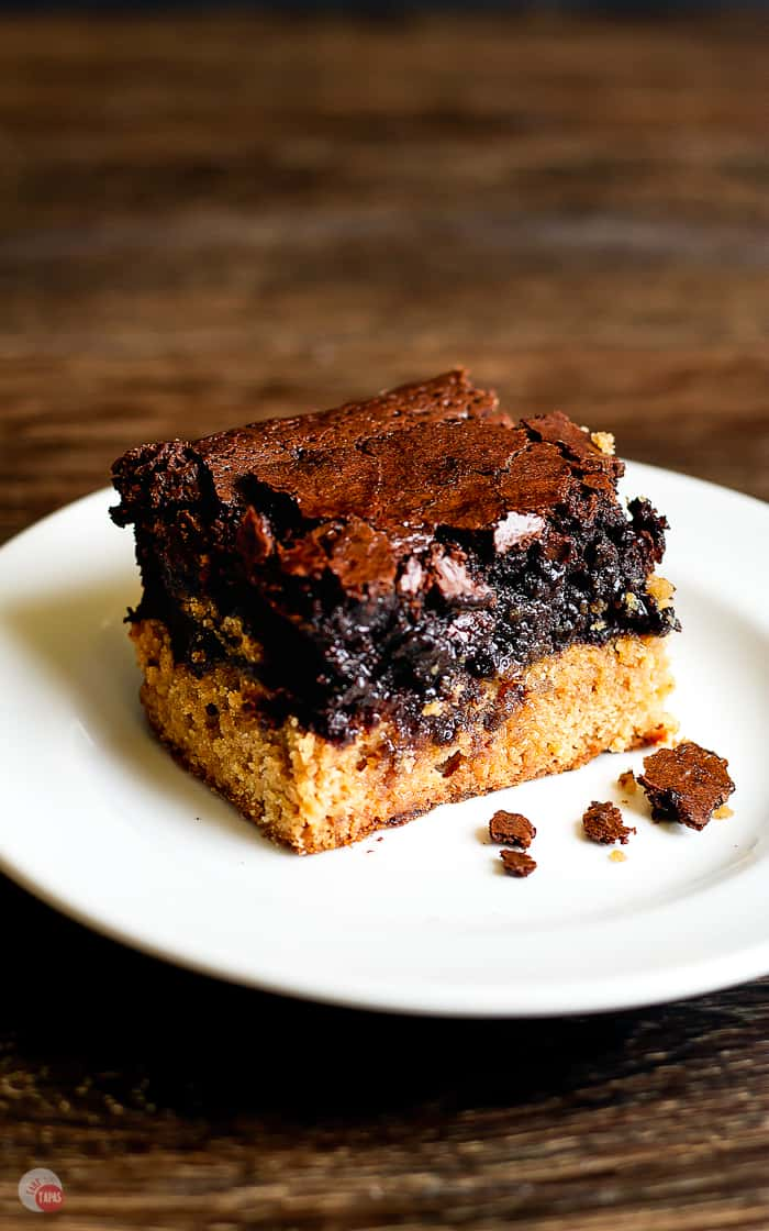 side view of peanut butter Oreo brownie bar on a white plate