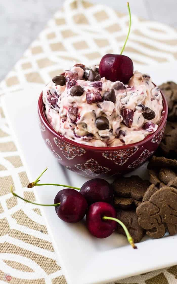 side view of platter of chocolate cherry dip and fresh cherrries