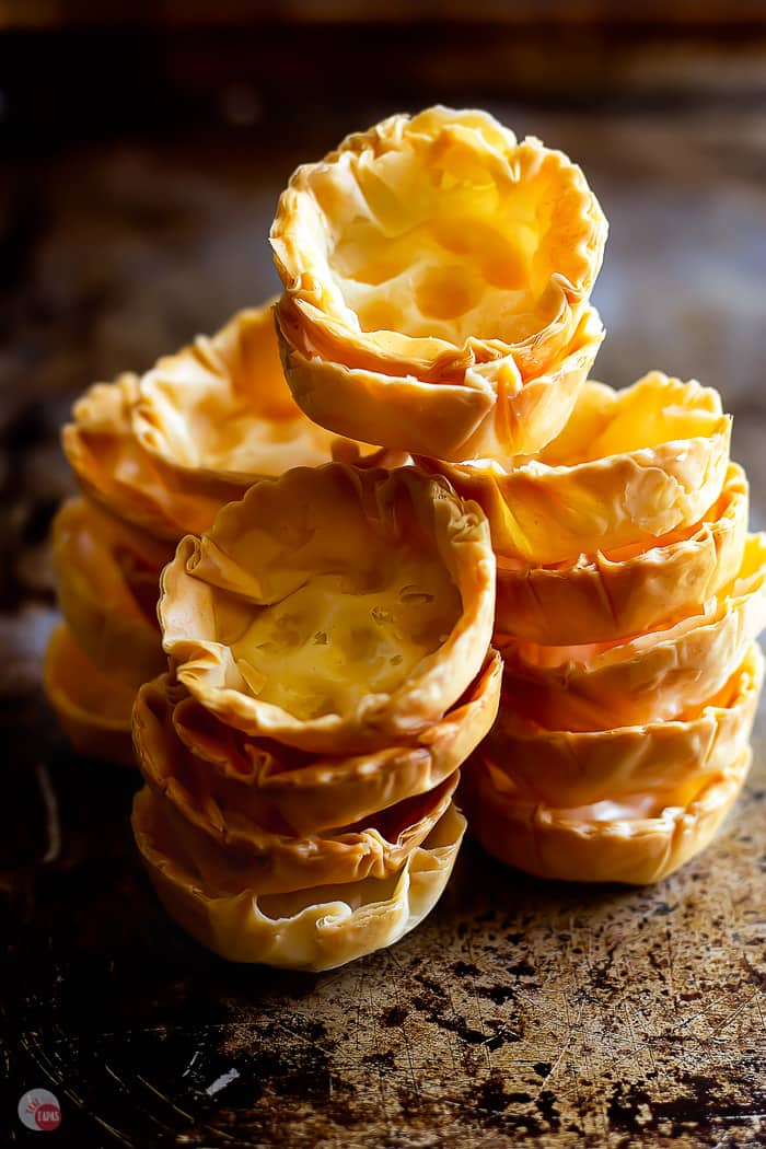 stacks of empty phyllo cups on a baking sheet