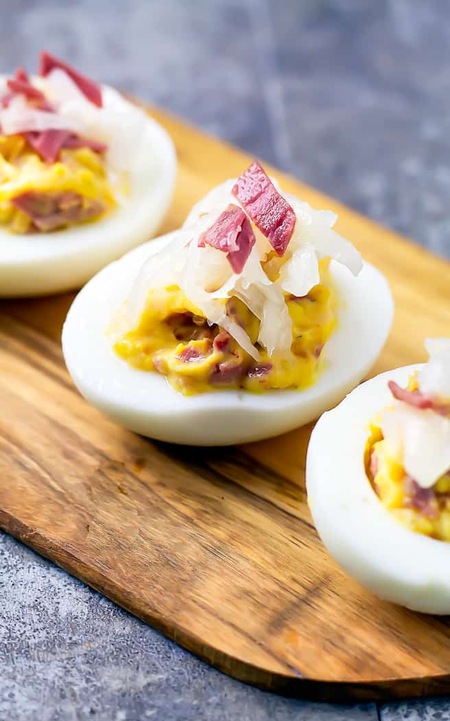 corned beef and sauerkraut in a deviled egg on wood platter