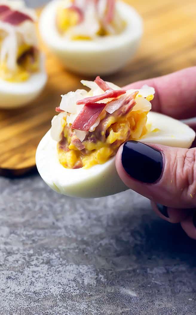 hand holding a Reuben deviled egg