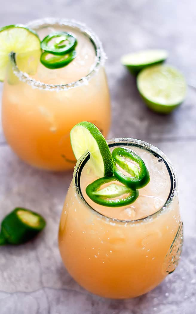 overhead picture of two cocktails with jalapeno slices as garnish