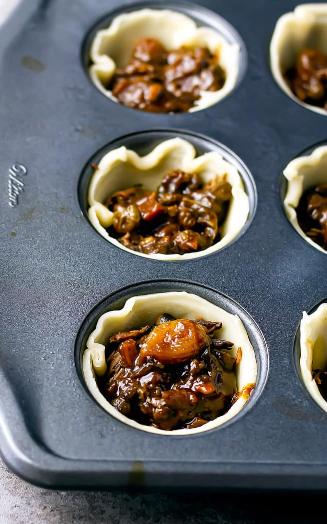 mini pie crusts with beef and sauce