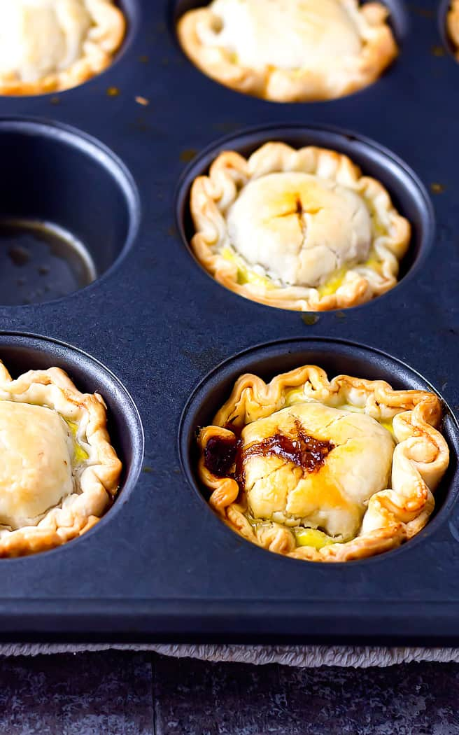 mini beef hand pies in a muffin tin