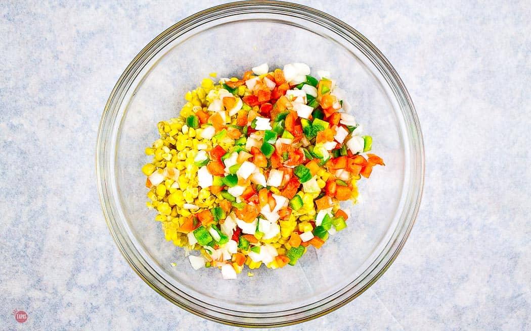 corn in a bowl with pico de gallo