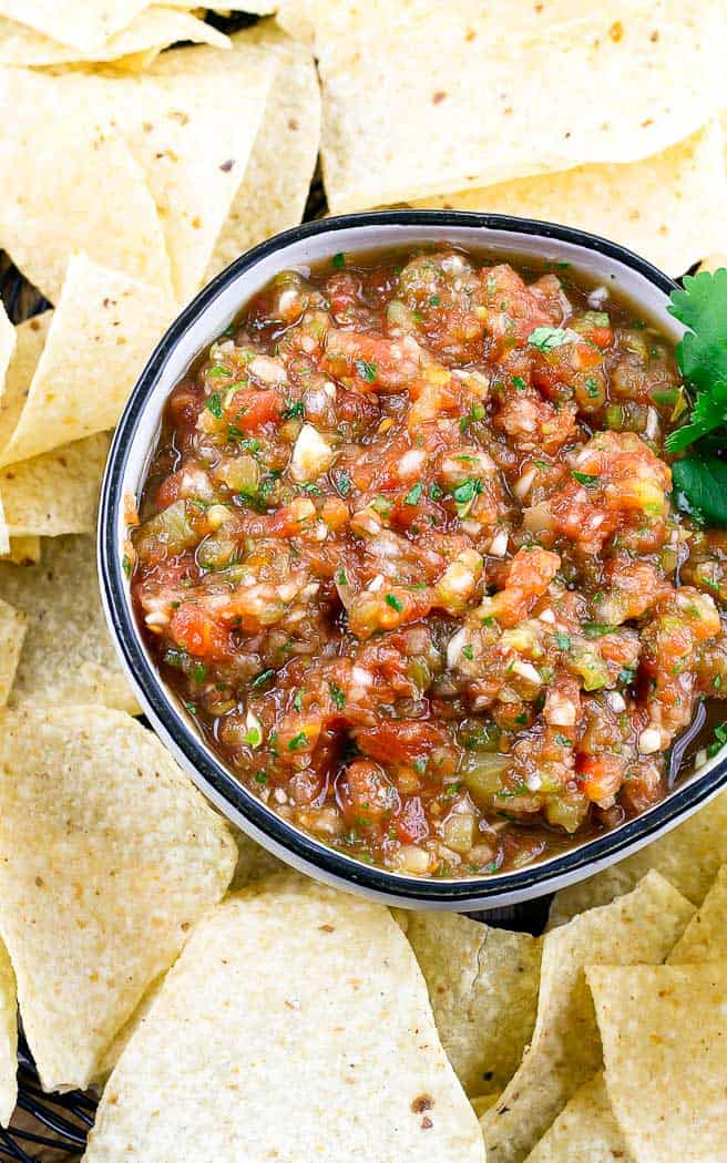 overhead picture of salsa in a bowl surrounded by chips