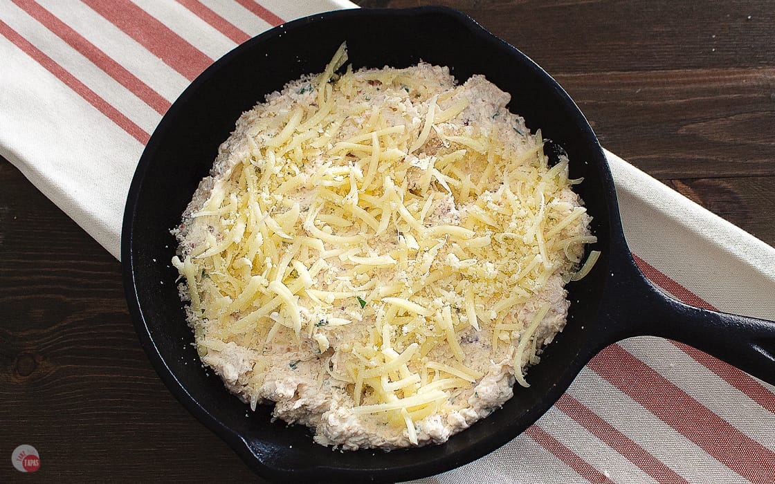 skillet with dip and cheese