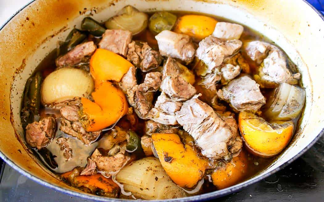 braised pork and onions in a pot