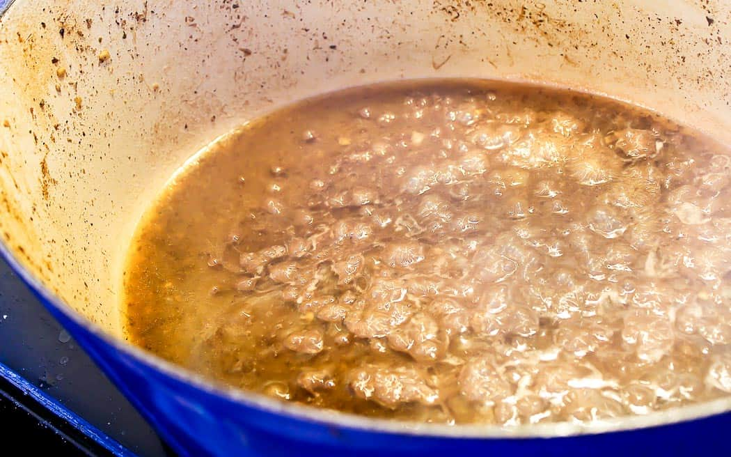 broth reducing in a stock pot