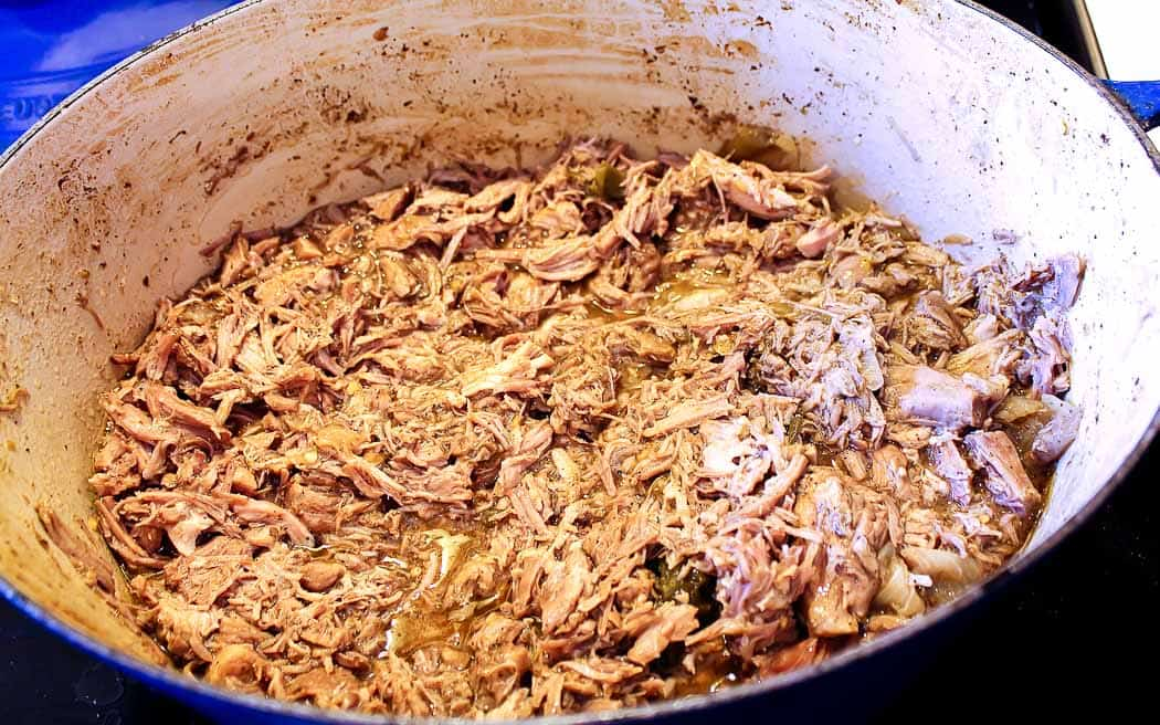 shredded pork and sauce in a blue pot