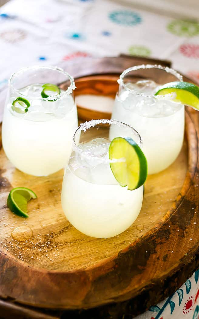 3 ingredients margarita in a glass with lime curls