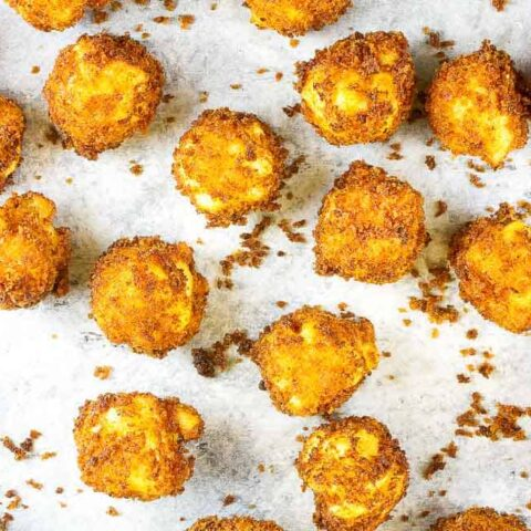 baking sheet with fried mac and cheese balls on it