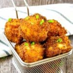 mac n cheese balls in a metal basket