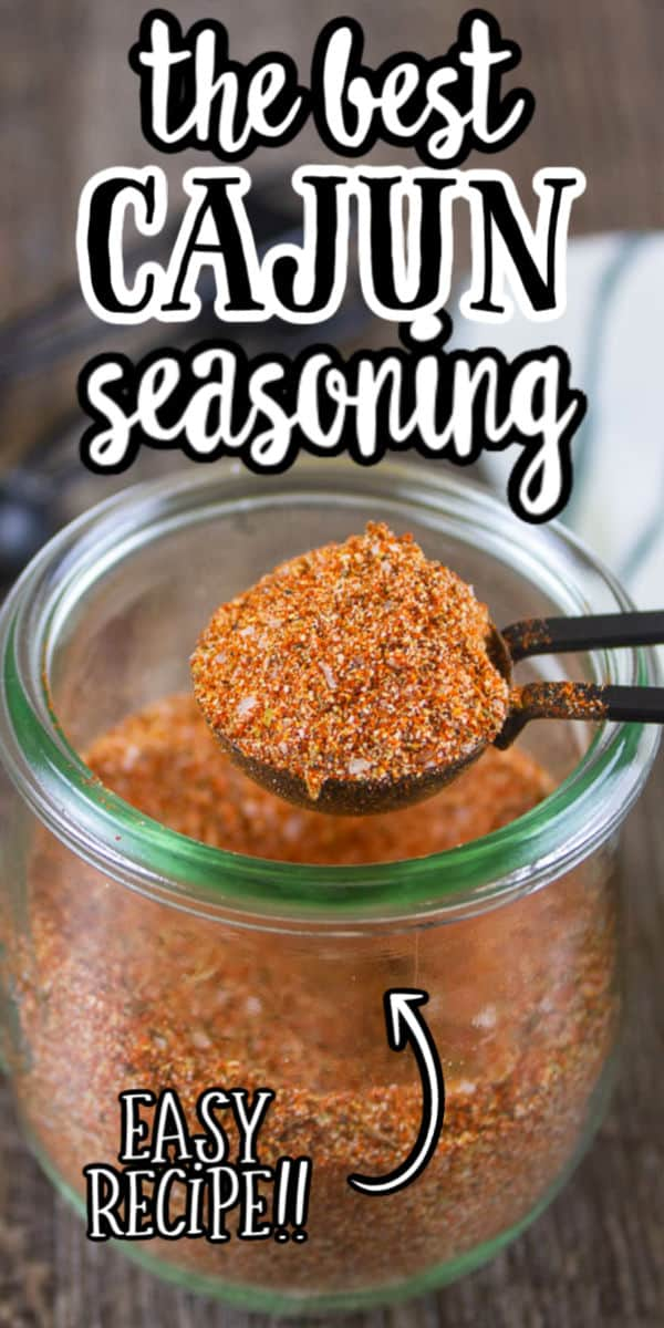 "pinterest image of cajun seasoning in a clear jar with text ""the best cajun seasoning - easy recipe"""