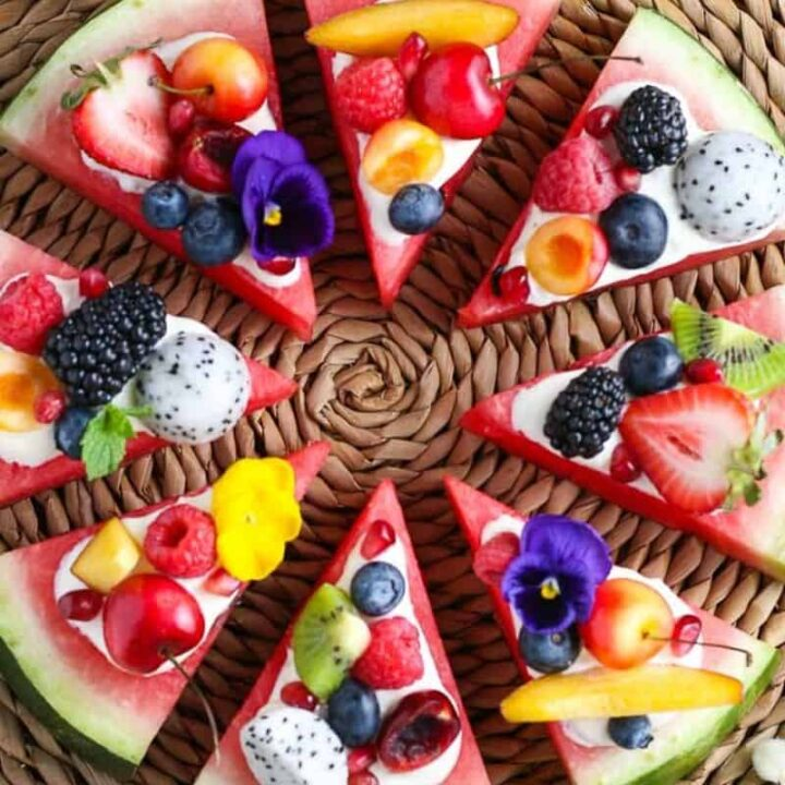 overhead picture of watermelon pizza on a straw plate