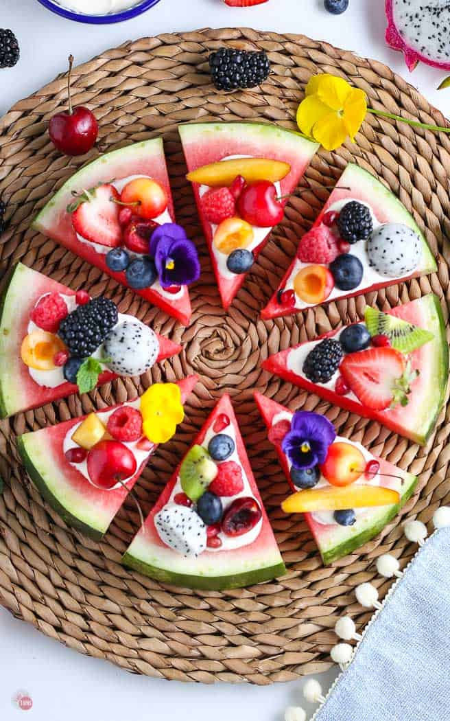 overhead picture of watermelon pizza on straw charger