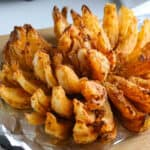square photo of blooming onion on foil