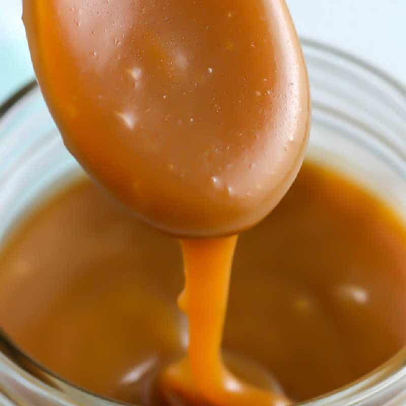 square picture of caramel sauce on a spoon for recipe card