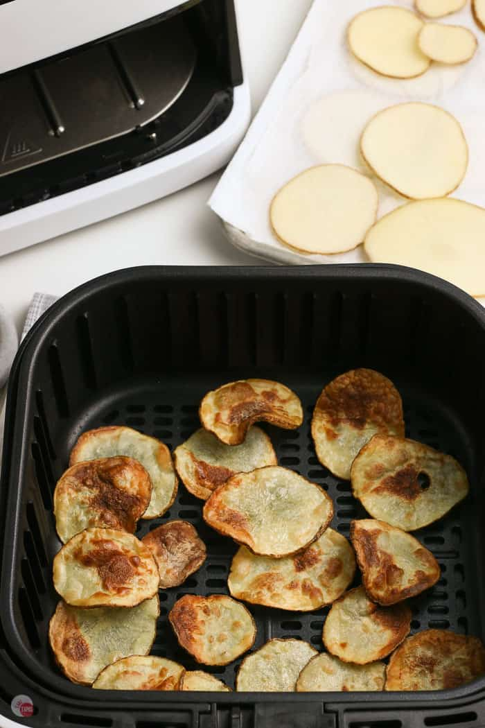 air fryer potato chips in a black basket