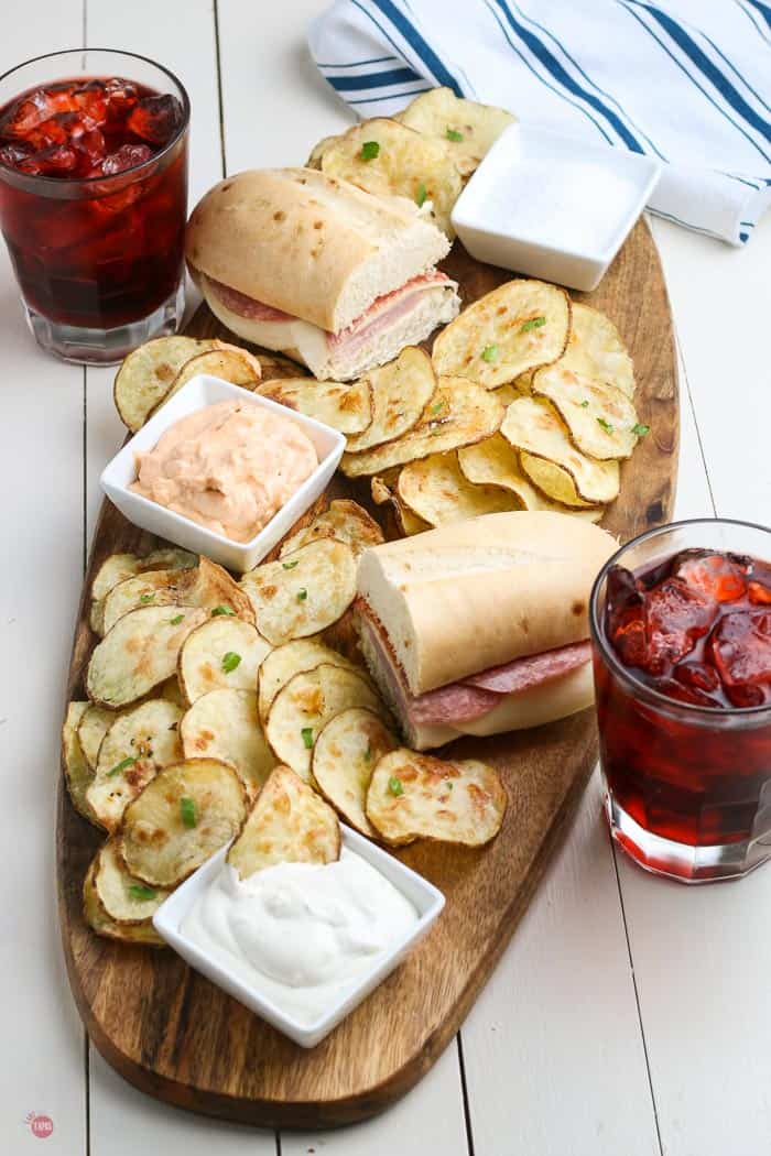 overhead picture of potato chips and sandwiches on a board