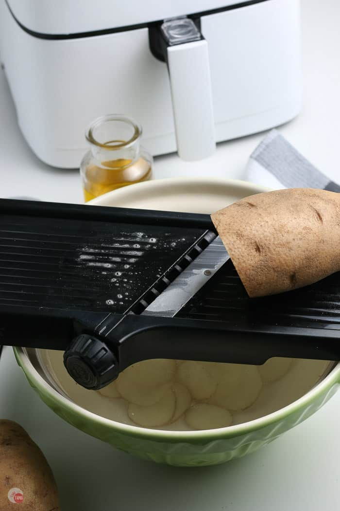 potato on a mandolin slicer