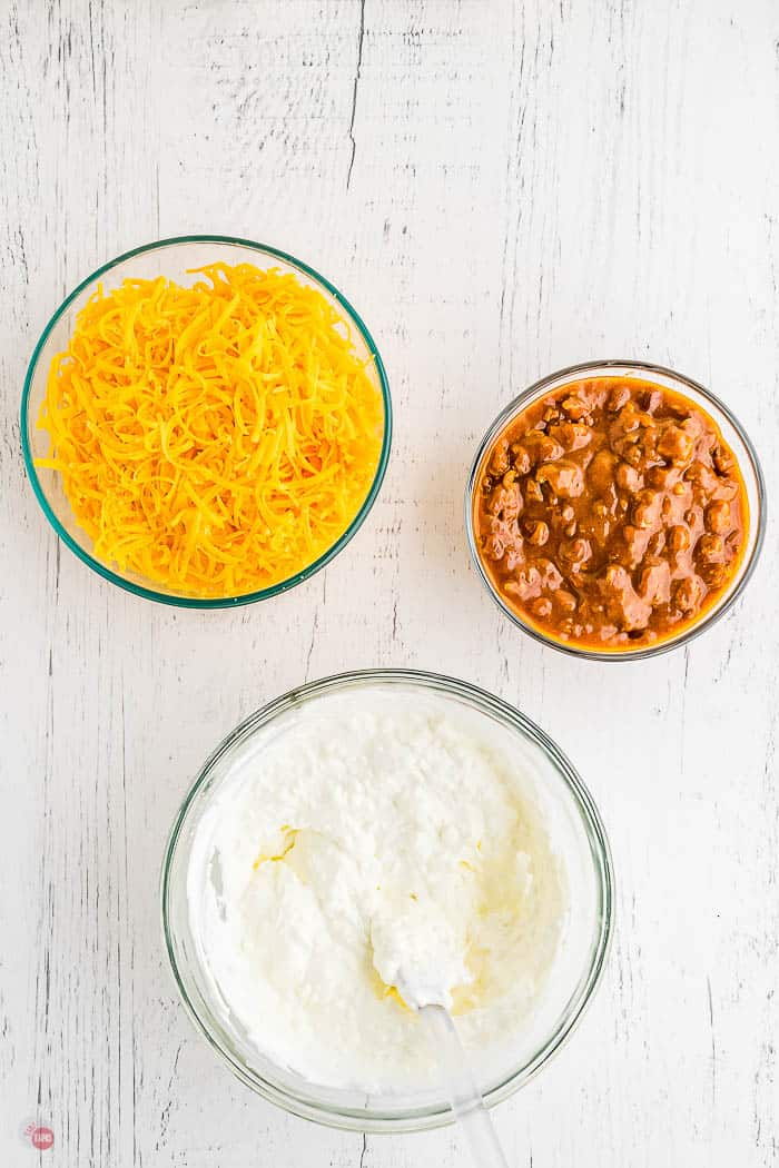 cream cheese, chili, and cheese in bowls