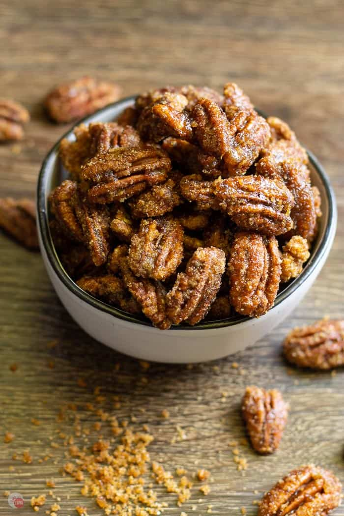 white bowl of gingersnap flavored candied pecans
