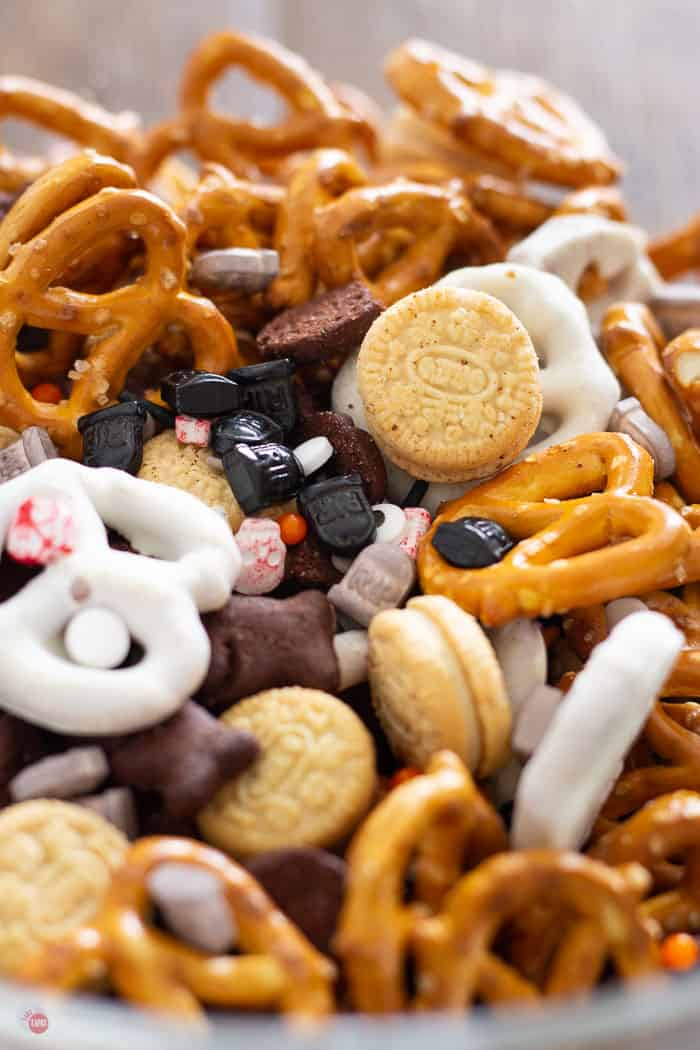 spooky halloween snack mix in a clear bowl