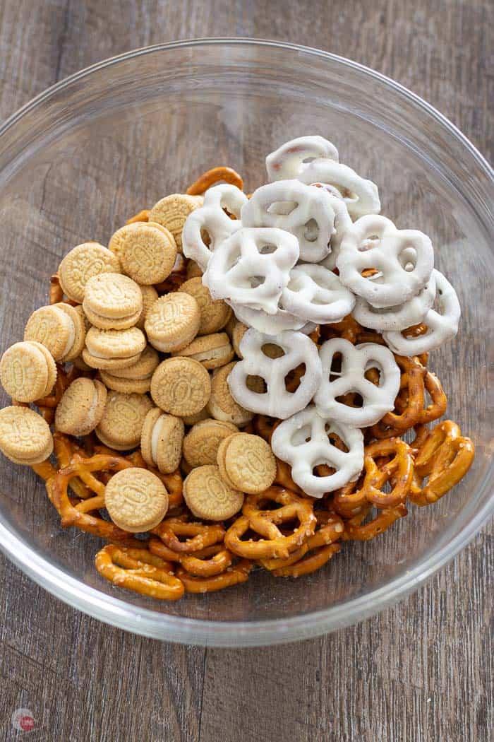 pretzels, mini oreo cookies, yogurt pretzels, in a clear bowl