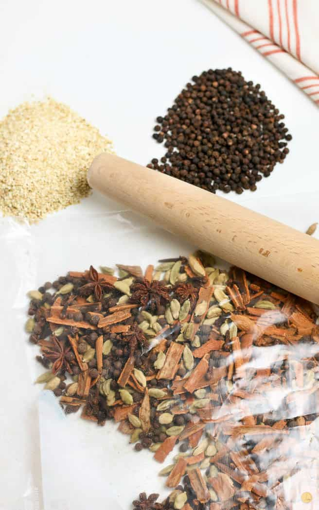 spices in a bag with a rolling pin