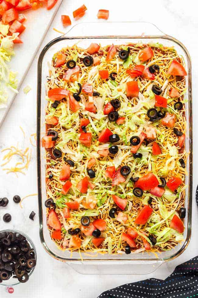 9x13 glass baking dish filled with 7 layer dip