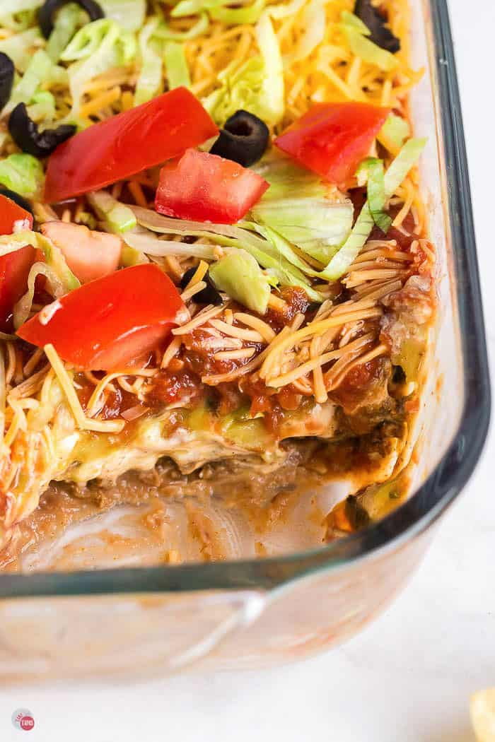 dish of taco dip with a section scooped out