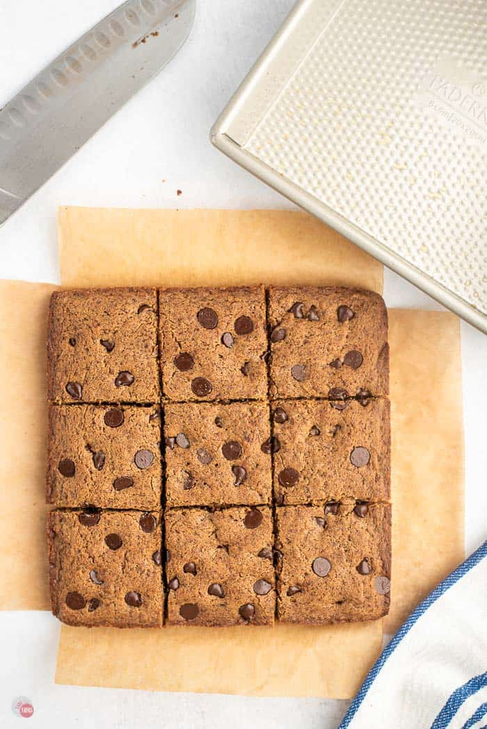 square of chocolate chip brownies cut into 9 squares