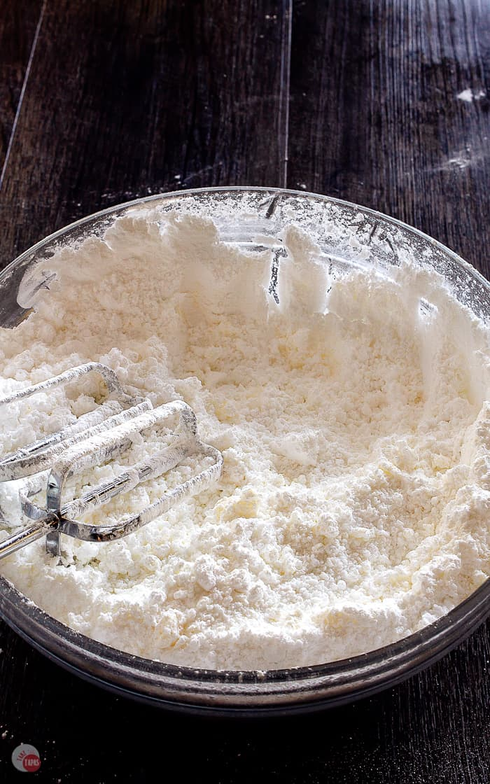 bowl of powdered sugar and butter with mixer