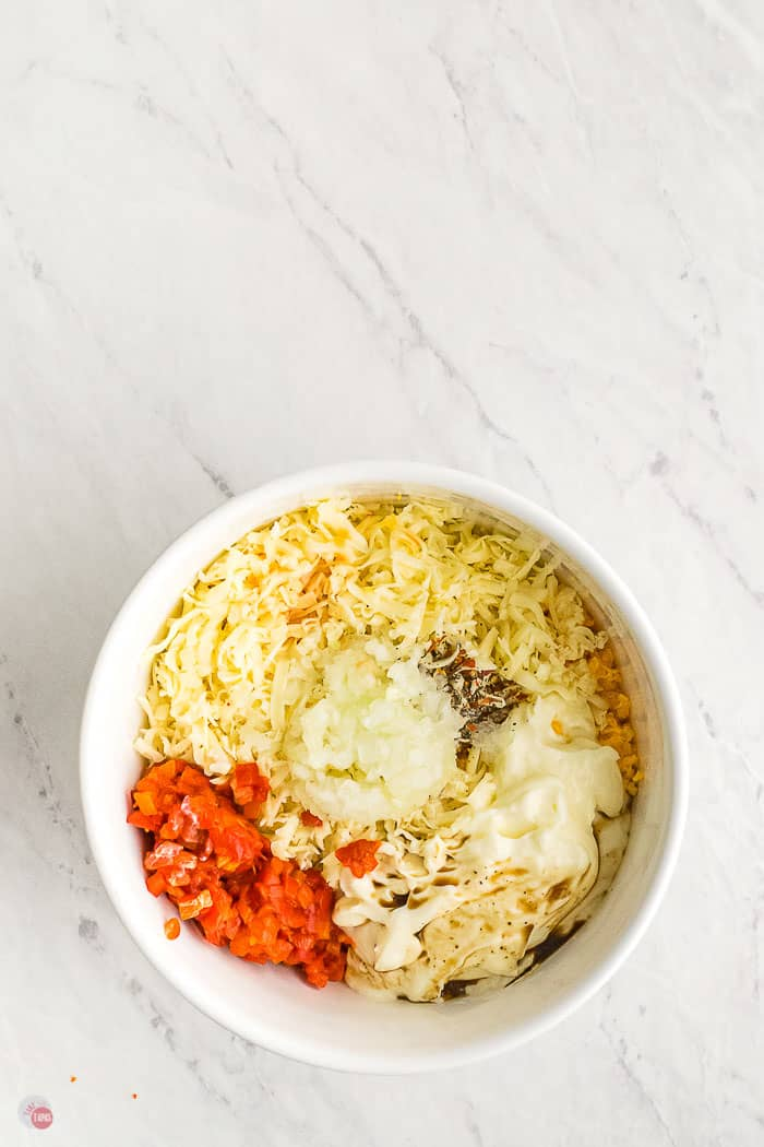 white bowl with pimento cheese spread ingredients unmixed