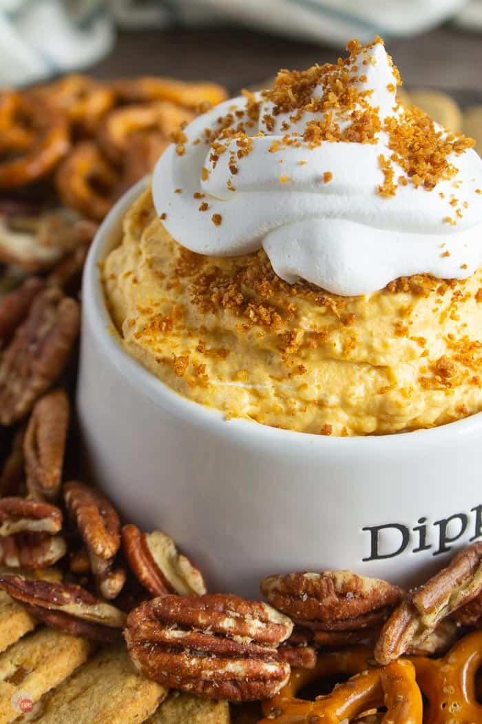 close up of pumpkin dip with cool whip on top