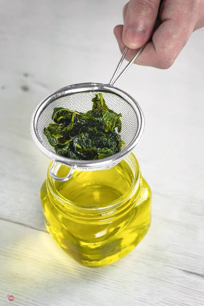 sieve of mint over a jar