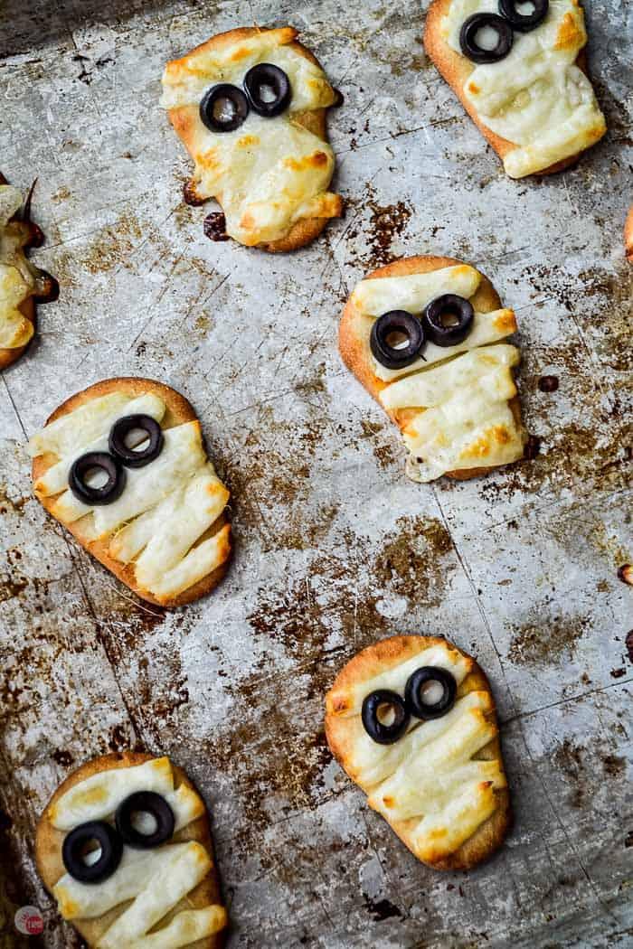 baked naan mummies on a baking sheet