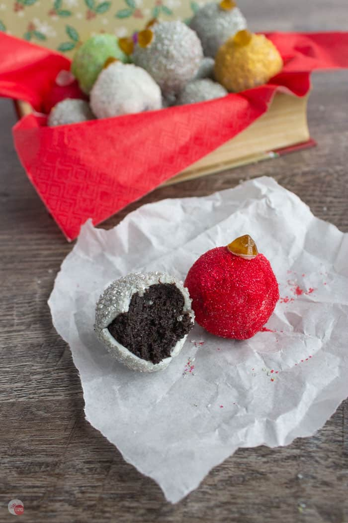 two oreo truffles on parchment paper